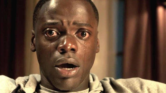Chris from Get Out stares at the camera with tears in his eyes