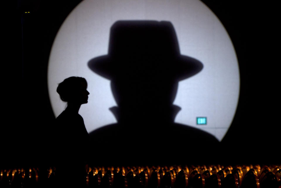 Speaker liaison Genevieve Netter is silhouetted against a Black Hat logo during the Black Hat USA 2014 hacker conference at the Mandalay Bay Convention Center in Las Vegas, Nevada August 6, 2014. REUTERS/Steve Marcus (UNITED STATES - Tags: SCIENCE TECHNOLOGY TPX IMAGES OF THE DAY)