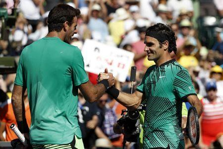 Mar 27, 2017; Miami, FL, USA; Roger Federer of Switzerland (R) shakes hands with Juan Martin del Potro of Argentina (L) after their match on day seven of the 2017 Miami Open at Crandon Park Tennis Center. Mandatory Credit: Geoff Burke-USA TODAY Sports