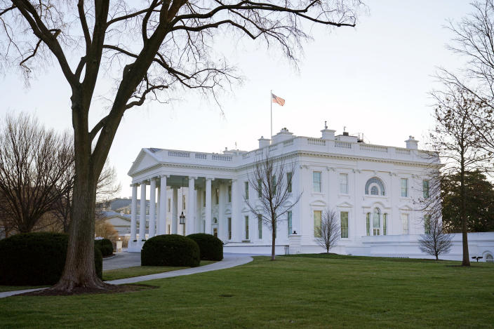 An American flag flies over the White House in Washington, Thursday, Jan. 7, 2021. (AP Photo/Patrick Semansky)