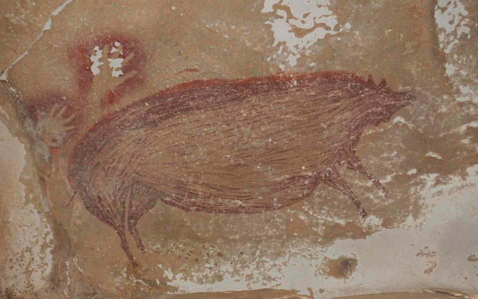 Archaeologists have discovered the world's oldest known cave painting: a life-sized picture of a wild pig that was made at least 45,500 years ago in Indonesia - Maxime Aubert/AFP
