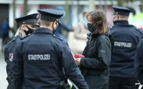 Officers of Frankfurt city police control pedestrians due to restrictions as the coronavirus disease (COVID-19) outbreak continues in Frankfurt