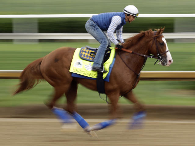 Kentucky Derby entrant Improbable runs during a workout at Churchill Downs Thursday, May 2, 2019, in Louisville, Ky. The 145th running of the Kentucky Derby is scheduled for Saturday, May 4. (AP Photo/Charlie Riedel)
