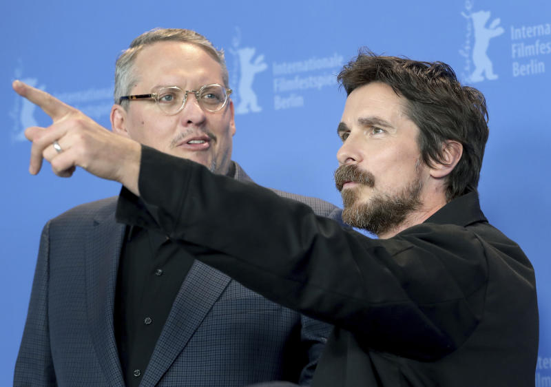 Director Adam McKay, left, and actor Christian Bale pose for the photographers during a photo call for the film 'Vice' at the 2019 Berlinale Film Festival in Berlin, Germany, Monday, Feb. 11, 2019. (AP Photo/Michael Sohn)