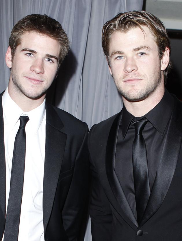 Chris Hemsworth and Liam Hemsworth photos: Looking dapper in their suits. Copyright [Getty]