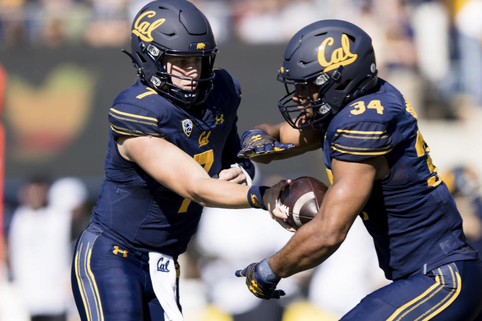 California quarterback Chase Garbers, left, hands off to running back Christopher Brooks in the first quarter of an NCAA college football game against Washington State in Berkeley, Calif., Saturday, Oct. 2, 2021. (AP Photo/John Hefti)