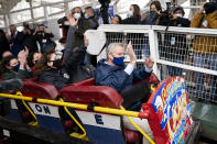 New York City Mayor Bill de Blasio rides the Cyclone rollercoaster after the ribbon cutting and seasonal opening of the Coney Island amusement park area, Friday, April 9, 2021, in the Brooklyn borough of New York. Coney Island's illustrious amusement parks are reopening Friday after the coronavirus pandemic shuttered them all last year. (AP Photo/John Minchillo)