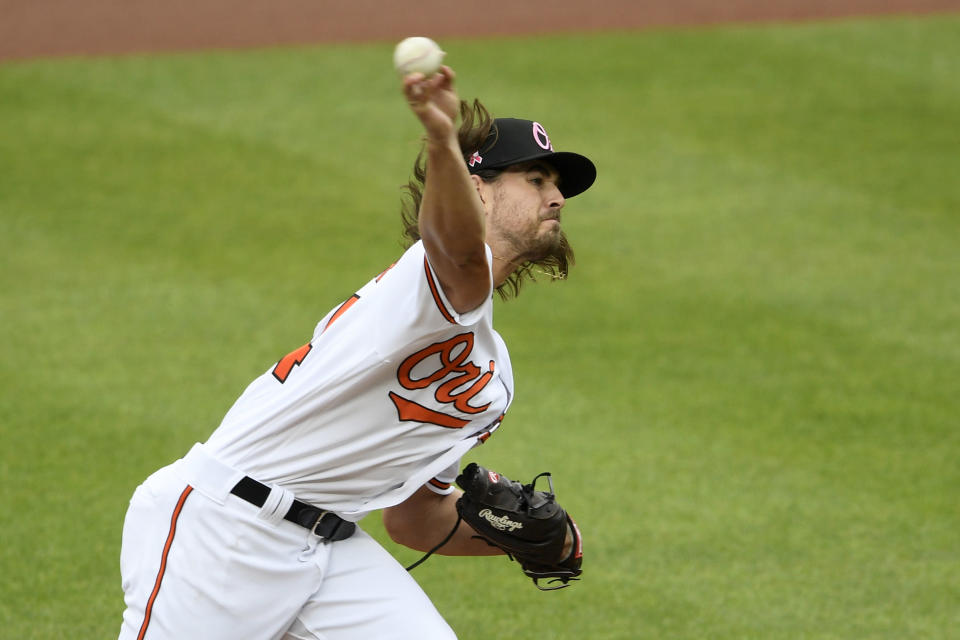 Baltimore Orioles starting pitcher Dean Kremer delivers a pitch during the first inning of a baseball game against the Boston Red Sox, Sunday, May 9, 2021, in Baltimore. (AP Photo/Nick Wass)