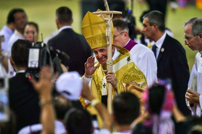 Pope Francis arrived at the stadium in a golden robe woven for him from Thai silk