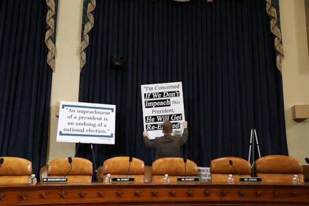 PHOTO: A congressional staffer puts up signs prior to testimony by constitutional scholars before the House Judiciary Committee in the Longworth House Office Building on Capitol Hill, Dec. 4, 2019, in Washington. (Chip Somodevilla/Getty Images)