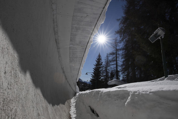 A view of the bobsled track in Cortina d'Ampezzo, Italy, Wednesday, Feb. 17, 2021. Bobsledding tradition in Cortina goes back nearly a century and locals are hoping that the Eugenio Monti track can be reopened for the 2026 Olympics in the Italian resort. (AP Photo/Gabriele Facciotti)