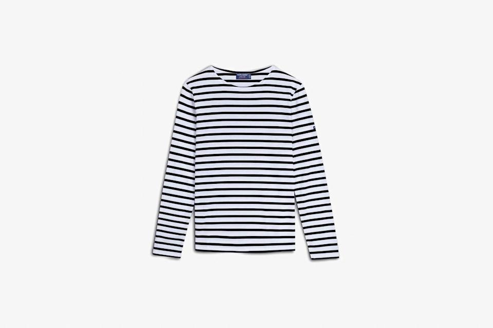 """The Breton shirt is so timelessly, stylishly French that we once wrote an entire story dedicated to the <a href=""""https://www.cntraveler.com/story/the-history-of-the-breton-shirt-from-sailors-to-chanel?mbid=synd_yahoo_rss"""" rel=""""nofollow noopener"""" target=""""_blank"""" data-ylk=""""slk:history of it"""" class=""""link rapid-noclick-resp"""">history of it</a>—and everyone from Brigitte Bardot to Jean Paul Gaultier has worn the traditional striped sailor top since Coco Chanel set the trend in 1913. There's no shortage of options to buy, but no one designs the shirt quite as well as French atelier Saint James, which has been making them for 130 years. You can choose from a range of color options, but we love the classic navy and white combo. $85, Saint James. <a href=""""https://www.saint-james.com/us/women/minquiers-moderne-unisex-breton-stripe-shirt.html"""" rel=""""nofollow noopener"""" target=""""_blank"""" data-ylk=""""slk:Get it now!"""" class=""""link rapid-noclick-resp"""">Get it now!</a>"""