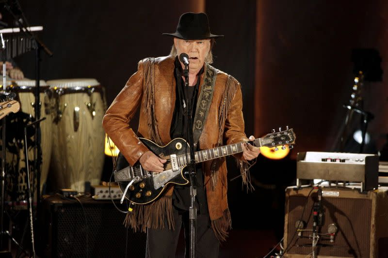FILE PHOTO: Singer/songwriter Neil Young performs during a concert honoring singer/songwriter Willie Nelson, recipient of the Library of Congress' Gershwin Prize for Popular Song, in Washington