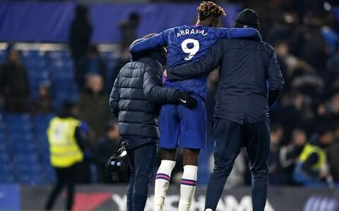 Tammy Abraham of Chelsea is helped off the pitch after the English Premier League match between Chelsea and Arsenal - Credit: Rex