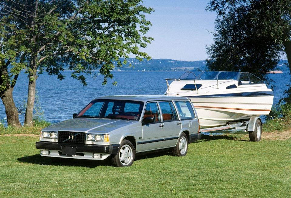 """<p>Volvo's formula for the 740 Turbo was simple: To its upper-end, rear-drive sedan and wagon, the Swedish automaker slapped on a turbocharger and some alloy wheels. It sounds dumb now, but the results were legitimate sleepers (particularly the boxy wagon) with 160(!) horsepower. Volvo pushed this idea—hard—in iconic print ads that pitted the Turbo wagon against period performance cars like the Lotus Esprit and the Porsche 944. The most ambitious placed a 740 Turbo wagon next to a Lamborghini Countach that's pulling a trailer and read: """"The basic idea behind the Volvo Turbo wagon."""" We really can't think of anything cooler than a juicebox-shaped, three-row station wagon with a drag-racing itch. <em>—Daniel Golson</em></p>"""