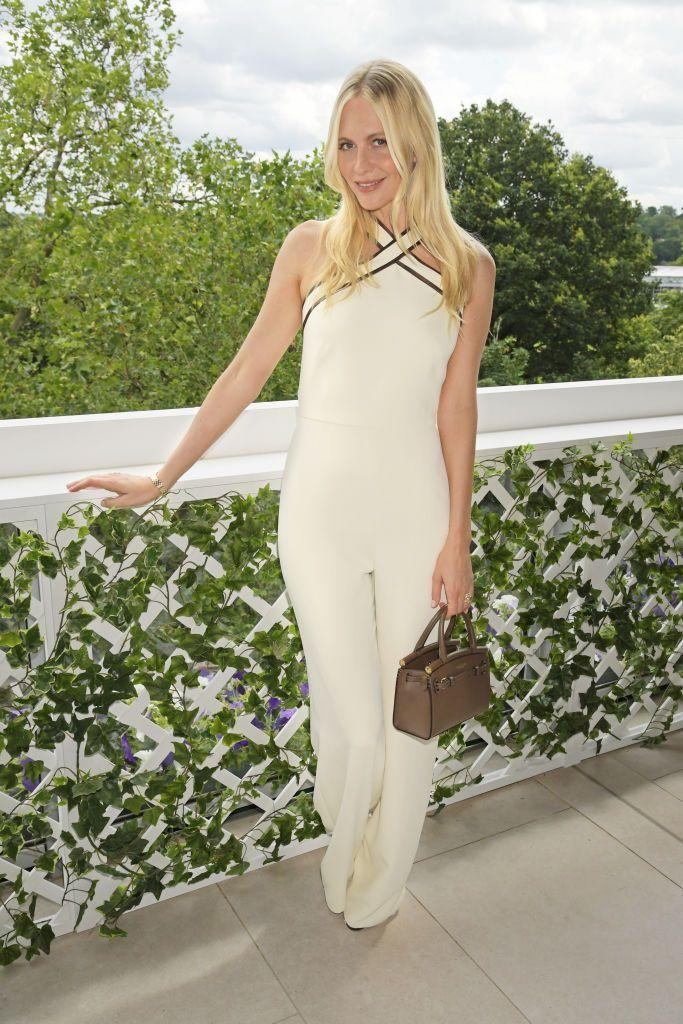 <p>The model wore a cream jumpsuit to the tennis. </p>