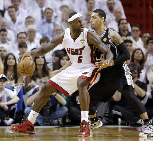 Miami Heat small forward LeBron James (6) and San Antonio Spurs shooting guard Danny Green (4) work during the first half of Game 1 of basketball's NBA Finals, Thursday, June 6, 2013 in Miami. (AP Photo/Lynne Sladky)