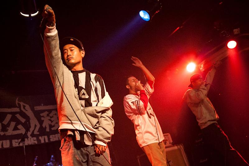 Three members of the rap group IN3, Chen Haoran (L), Jia Wei (C) and Meng Guodong, perform in Beijing on September 17, 2010 (AFP Photo/Li Lewei )
