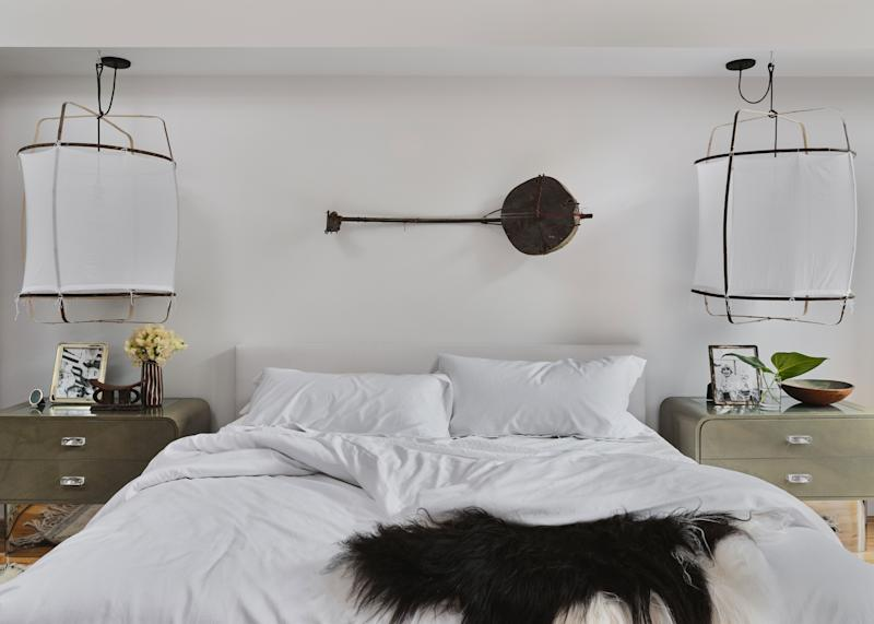"""The star of the master bedroom, the 100-year-old South African ngoni, is a honeymoon souvenir the couple will always adore. """"Our ngoni traveled with us by car to the Western Cape Winelands, to the beaches of Mozambique, and everywhere in between,"""" says the client."""