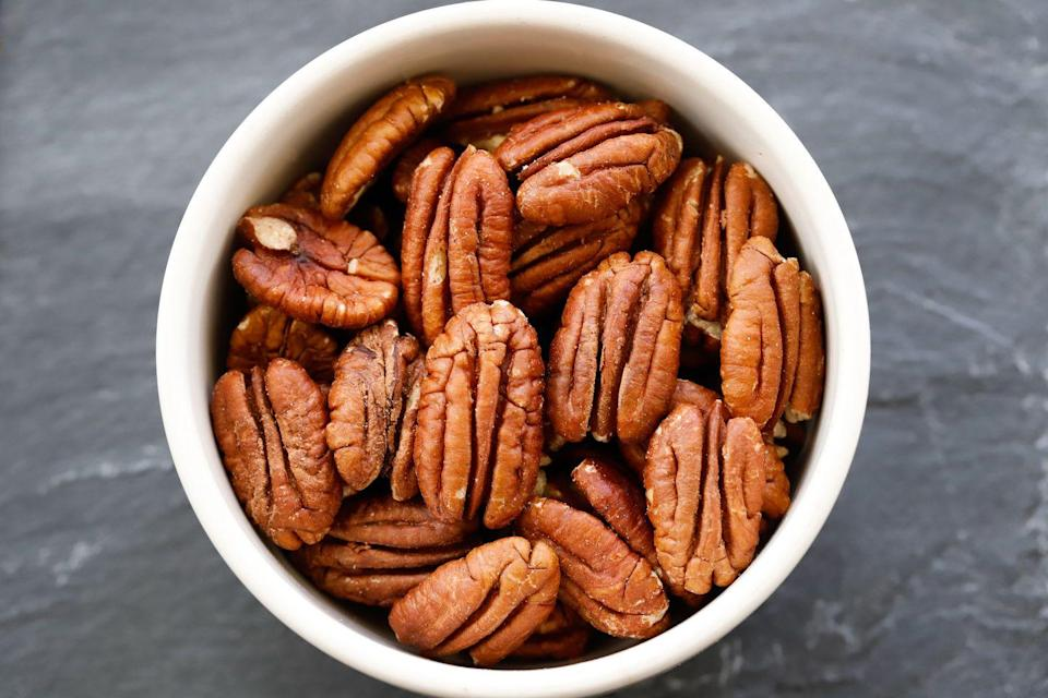 """<p><a href=""""//www.runnersworld.com/news/a29485347/nuts-in-diet-weight-loss/"""" data-ylk=""""slk:Nuts"""" class=""""link rapid-noclick-resp"""">Nuts</a> and nut butter makes a more balanced bowl of oatmeal, says Blatner. """"They add that necessary component of protein and healthy fat, but that adds up really fast. Because of their higher fat content, they have more calories per gram—so even if you use a small amount, that's a lot of calories."""" </p><p>While it's true <a href=""""http://www.womenshealthmag.com/weight-loss/fats-for-weight-loss"""" rel=""""nofollow noopener"""" target=""""_blank"""" data-ylk=""""slk:healthy fats"""" class=""""link rapid-noclick-resp"""">healthy fats</a> are <a href=""""https://patty-runnersworld.hearstapps.com/tag/fats"""" rel=""""nofollow noopener"""" target=""""_blank"""" data-ylk=""""slk:essential for good nutrition and running performance"""" class=""""link rapid-noclick-resp"""">essential for good nutrition and running performance</a> and can even boost <a href=""""https://patty-runnersworld.hearstapps.com/tag/weight-loss"""" rel=""""nofollow noopener"""" target=""""_blank"""" data-ylk=""""slk:weight loss"""" class=""""link rapid-noclick-resp"""">weight loss</a> or maintenance, eating too much can sabotage your goals. Instead of tossing on several handfuls, keep it to just one serving of nuts, which equals about an ounce or 1 to 2 tablespoons of nut butter. </p>"""