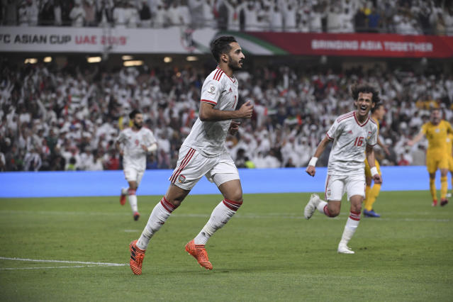 United Arab Emirates' forward Ali Mabkhout, celebrates his goal, the opening goal, during the AFC Asian Cup quarterfinal soccer match between United Arab Emirates and Australia at Hazza Bin Zayed Stadium in Al Ain, United Arab Emirates, Friday, Jan. 25, 2019. (AP Photo/Hassan Ammar)
