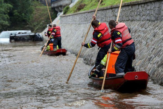 Austrian firefighters steer a boat in a flooded street in Pepinster on July 16, 2021, where the situation remains critical after the heavy rainfall of the previous days. - The death toll from devastating floods in Europe soared to at least 126 on July 16, 2021, most in western Germany where emergency responders were frantically searching for missing people. In Belgium, the government confirmed the death toll had jumped to 20 -- earlier reports had said 23 dead -- with more than 21,000 people left without electricity in one region. (Photo by François WALSCHAERTS / AFP) (Photo by FRANCOIS WALSCHAERTS/AFP via Getty Images) (Photo: FRANCOIS WALSCHAERTS via Getty Images)