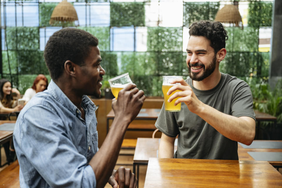 Friends enjoy a beer in Bueona Aires, the city is one of the cheapest places in the world to buy a pint (Stock, Getty)
