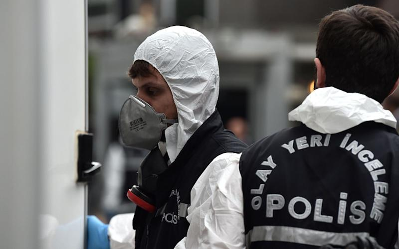 A team of a dozen police and prosecutors, including forensics experts in white overalls, entered the residence of Mohammed al-Otaibi - AFP