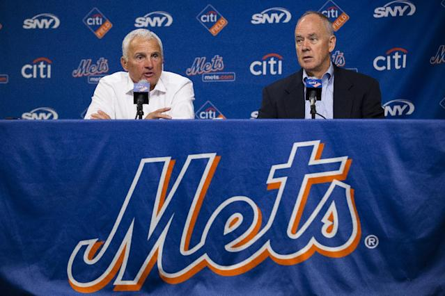 New York Mets manager Terry Collins, left, speaks to the media alongside general manager Sandy Alderson during a news conference at Citi Field, Monday, Sept. 30, 2013, in New York. The Mets have announced a two-year extension for Collins with a club option in 2016. (AP Photo/John Minchillo)
