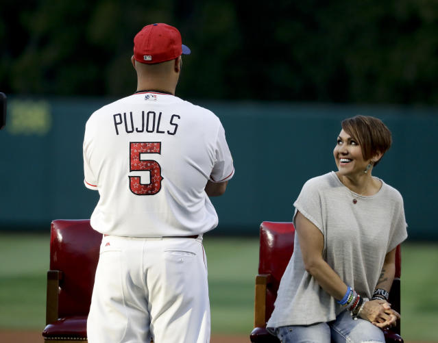 Albert Pujols watches during a ceremony honoring his 600th career home run as his wife Deidre looks on in Anaheim, Calif., Saturday, July 1, 2017. (AP)