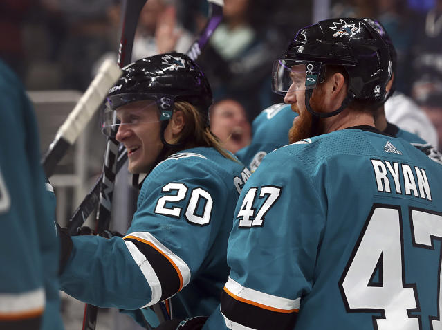 San Jose Sharks' Marcus Sorensen, left, is congratulated by Joakim Ryan (47) after scoring a goal against the Minnesota Wild during the first period of an NHL hockey game Tuesday, Nov. 6, 2018, in San Jose, Calif. (AP Photo/Ben Margot)