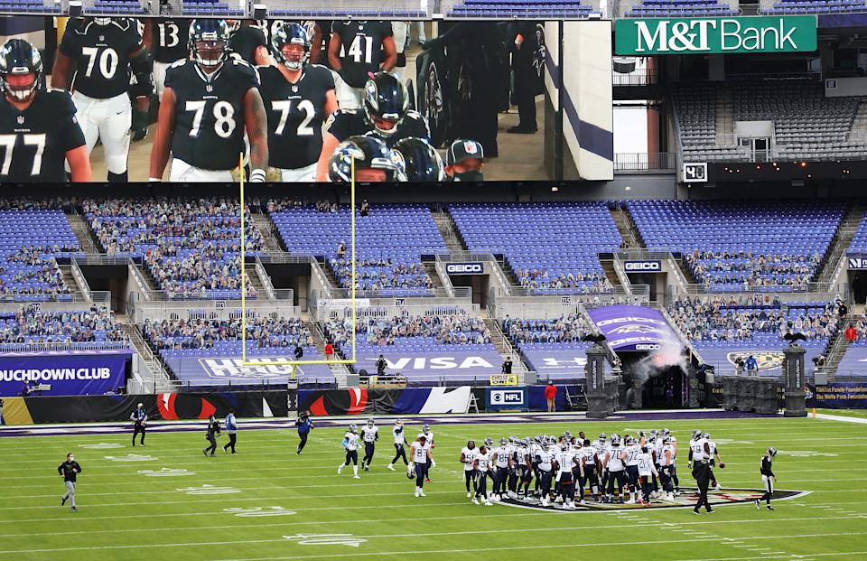 The Titans gathered on the Ravens' logo before Sunday's win. (Rob Carr/Getty Images)