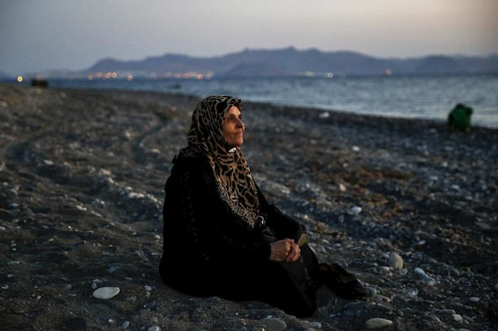 <p>Amoun, 70, a blind Palestinian refugee who lived in the town of Aleppo in Syria, rests on a beach moments after arriving along with 40 others on a dinghy, on the Greek island of Kos, Aug. 12, 2015. <i>(Yannis Behrakis/Reuters)</i></p>