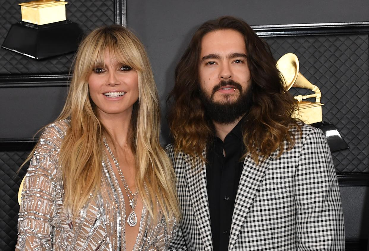US-German model Heidi Klum and husband musician Tom Kaulitz arrive for the 62nd Annual Grammy Awards on January 26, 2020, in Los Angeles. (Photo by VALERIE MACON / AFP) (Photo by VALERIE MACON/AFP via Getty Images)