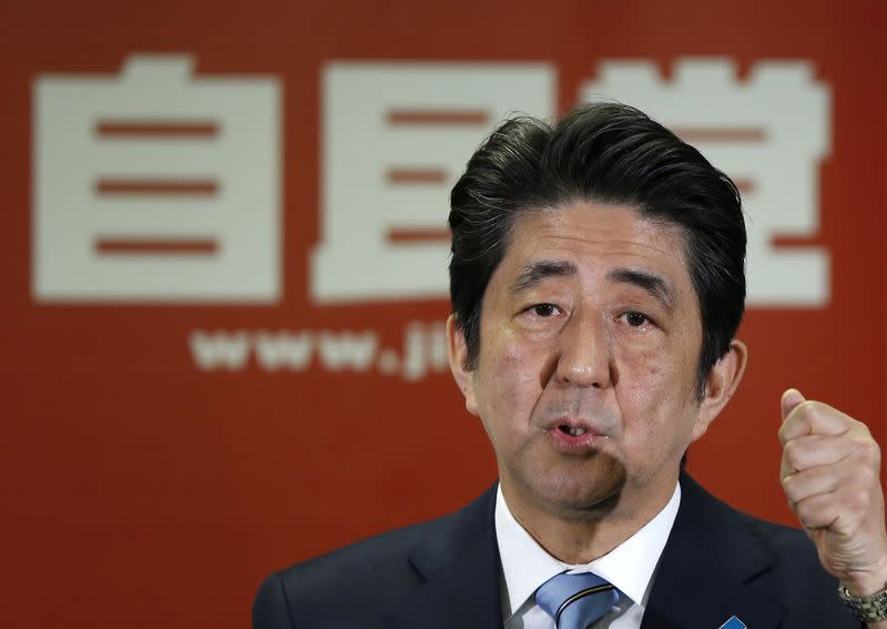Japan's Prime Minister and the leader of the ruling Liberal Democratic Party, Shinzo Abe, attends a news conference following a victory in the lower house elections by his ruling coalition in Tokyo