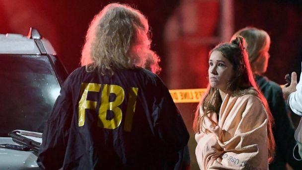 PHOTO: An FBI agent talks to a potential witness as they stand near the scene, Nov. 8, 2018, in Thousand Oaks, Calif. where a gunman opened fire Wednesday inside a country dance bar crowded with hundreds of people on 'college night.' (Mark J. Terrill/AP)
