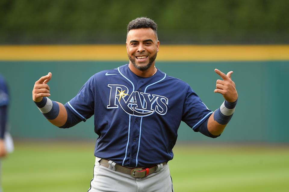 CLEVELAND, OHIO - JULY 23: Nelson Cruz #23 of the Tampa Bay Rays celebrates prior to the game against the Cleveland Indians at Progressive Field on July 23, 2021 in Cleveland, Ohio. (Photo by Jason Miller/Getty Images)