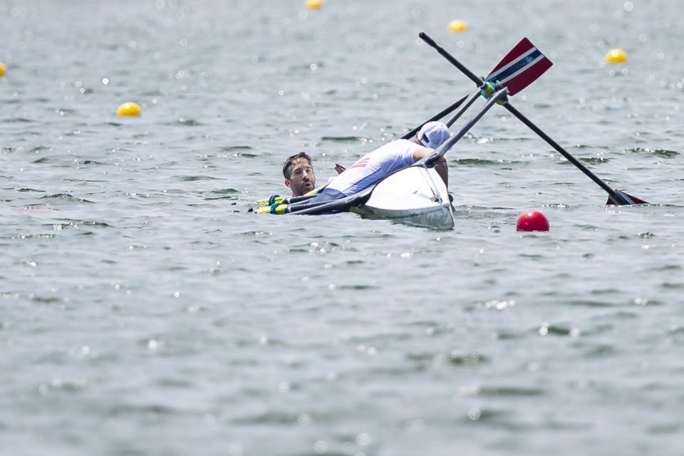 <p>TOKYO, JAPAN - JULY 28: (BILD ZEITUNG OUT) Kristoffer Brun of Norway and Are Weierholt Strandli of Norwegen lie in the water during the men's semi-final in the lightweight double sculls during Rowing on day five of the Tokyo 2020 Olympic Games at Sea Forest Waterway on July 28, 2021 in Tokyo, Japan. (Photo by Tom Weller/DeFodi Images via Getty Images)</p>