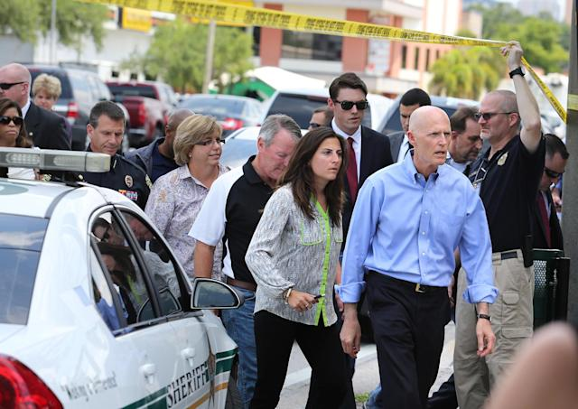 <p>Florida Gov. Rick Scott arrives on the scene near the nightclub where a mass shooting occured in Orlando, Fla., June 12, 2016. (Joe Burbank/Orlando Sentinel via AP) </p>
