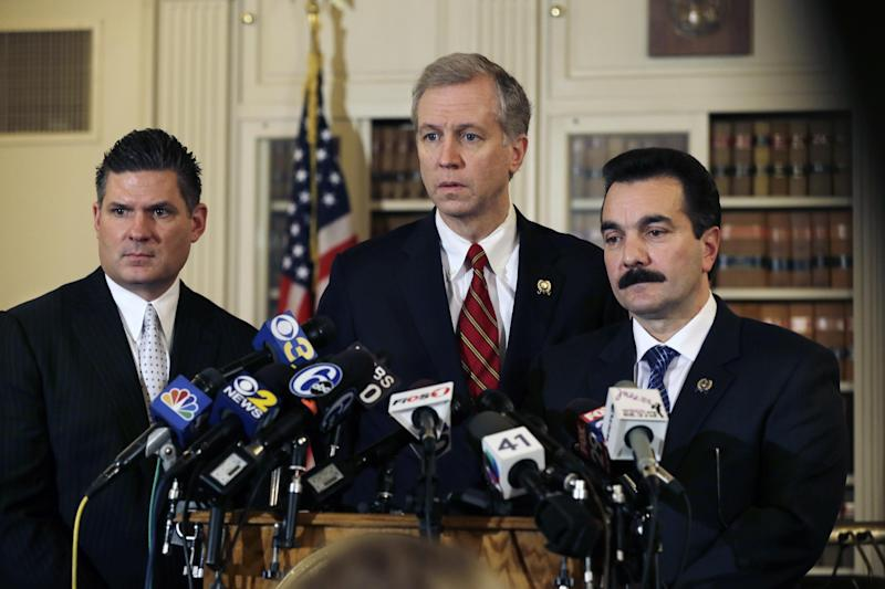 New Jersey Assemblymen John S. Wisniewski, center, D-Sayreville, N.J., Lou D. Greenwald, left, D-Vorhees, N.J., and incoming Assembly Speaker Vincent Prieto, D-Secaucus, N.J., address the media Monday, Jan. 13, 2014, in Trenton, N.J. Greenwald, says an investigation into massive local traffic jams that has ensnared Gov. Chris Christie's administration has grown into an abuse of power probe. (AP Photo/Mel Evans)