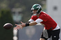 New York Jets quarterback Mike White tosses the ball during NFL football practice Wednesday, July 28, 2021, in Florham Park, N.J. (AP Photo/Adam Hunger)