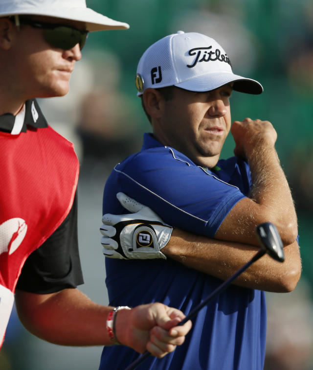 Erik Compton of the US prepares to play off the 4th tee during the first day of the British Open Golf championship at the Royal Liverpool golf club, Hoylake, England, Thursday July 17, 2014. (AP Photo/Alastair Grant)