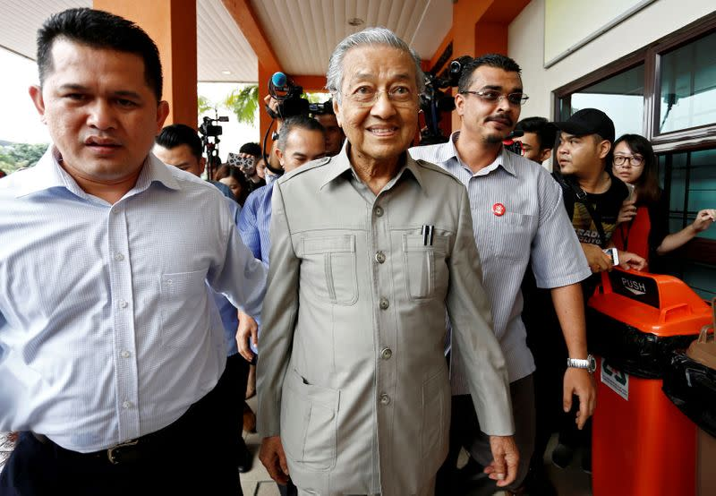 FILE PHOTO: Former Malaysian Prime Minister Mahathir Mohamad arrives to visit jailed opposition leader Anwar Ibrahim, who is recuperating from surgery, at Cheras Rehabilitation Hospital in Kuala Lumpur