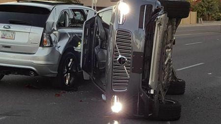 A self-driven Volvo SUV owned and operated by Uber Technologies Inc. is flipped on its side after a collision in Tempe, Arizona, U.S. on March 24, 2017. Picture taken on March 24, 2017.   Courtesy FRESCO NEWS/Mark Beach/Handout via REUTERS