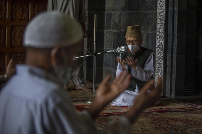 Kashmiri men take part in Friday prayers inside Jamia Masjid, or Grand Mosque, that remained closed for nearly five months due to the COVID-19 pandemic in Srinagar, Indian Controlled Kashmir, Friday, Aug. 6, 2021. (AP Photo/ Dar Yasin)