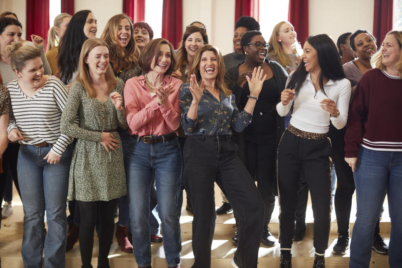 The choir celebrates in a scene from <i>Military Wives</i>. (Lionsgate)