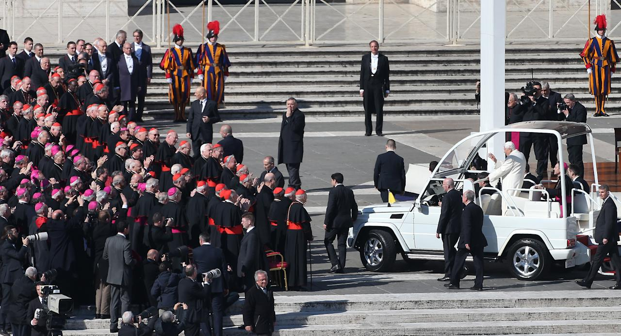 VATICAN CITY, VATICAN - FEBRUARY 27:  Pope Benedict XVI waves to Bishops (L) and Cardinals (2L)  as he arrives in St Peter's Square in the Popemobile on February 27, 2013 in Vatican City, Vatican.  The Pontiff has attended his last weekly public audience before stepping down tomorrow. Pope Benedict XVI has been the leader of the Catholic Church for eight years and is the first Pope to retire since 1415. He cites ailing health as his reason for retirement and will spend the rest of his life in solitude away from public engagements.  (Photo by Peter Macdiarmid/Getty Images)