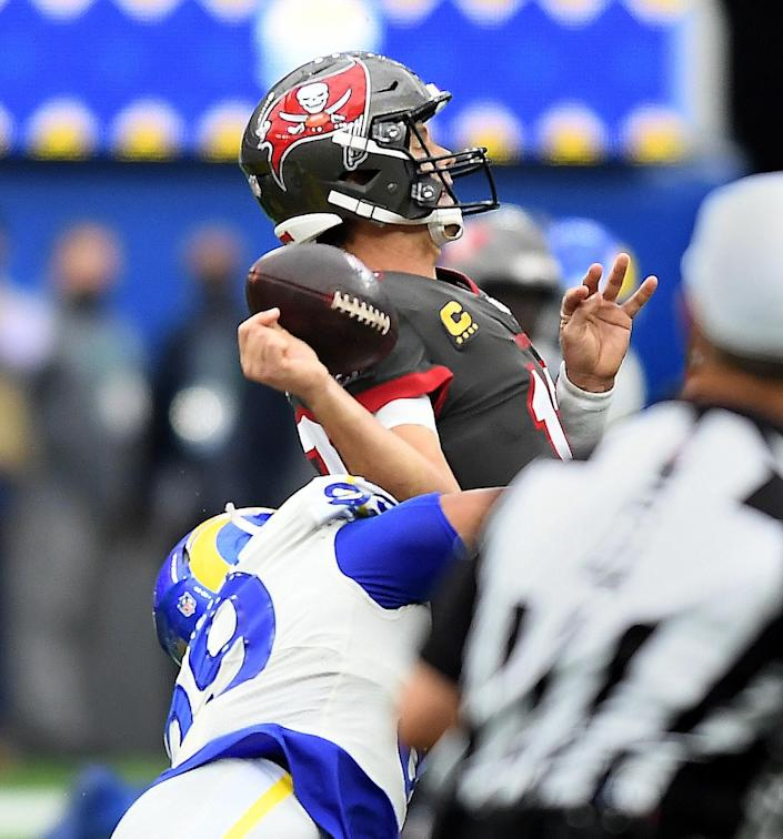 Rams defensive lineman Aaron Donald forces a fumble by Buccaneers quarterback Tom Brady,