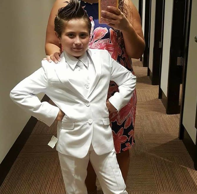 Cady wearing her special First Communion suit during a fitting.