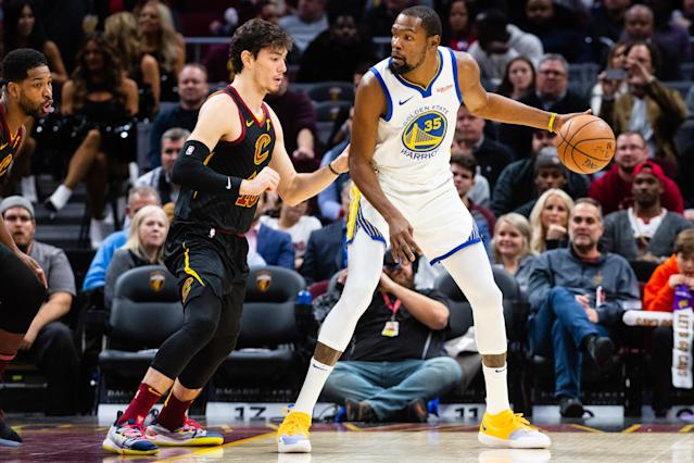 Kevin Durant works against Cedi Osman on Wednesday night. (Getty)